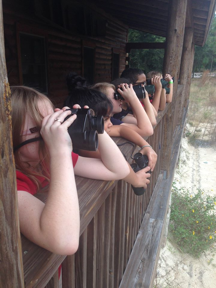 Students look through binoculars at Oakland Nature Preserve