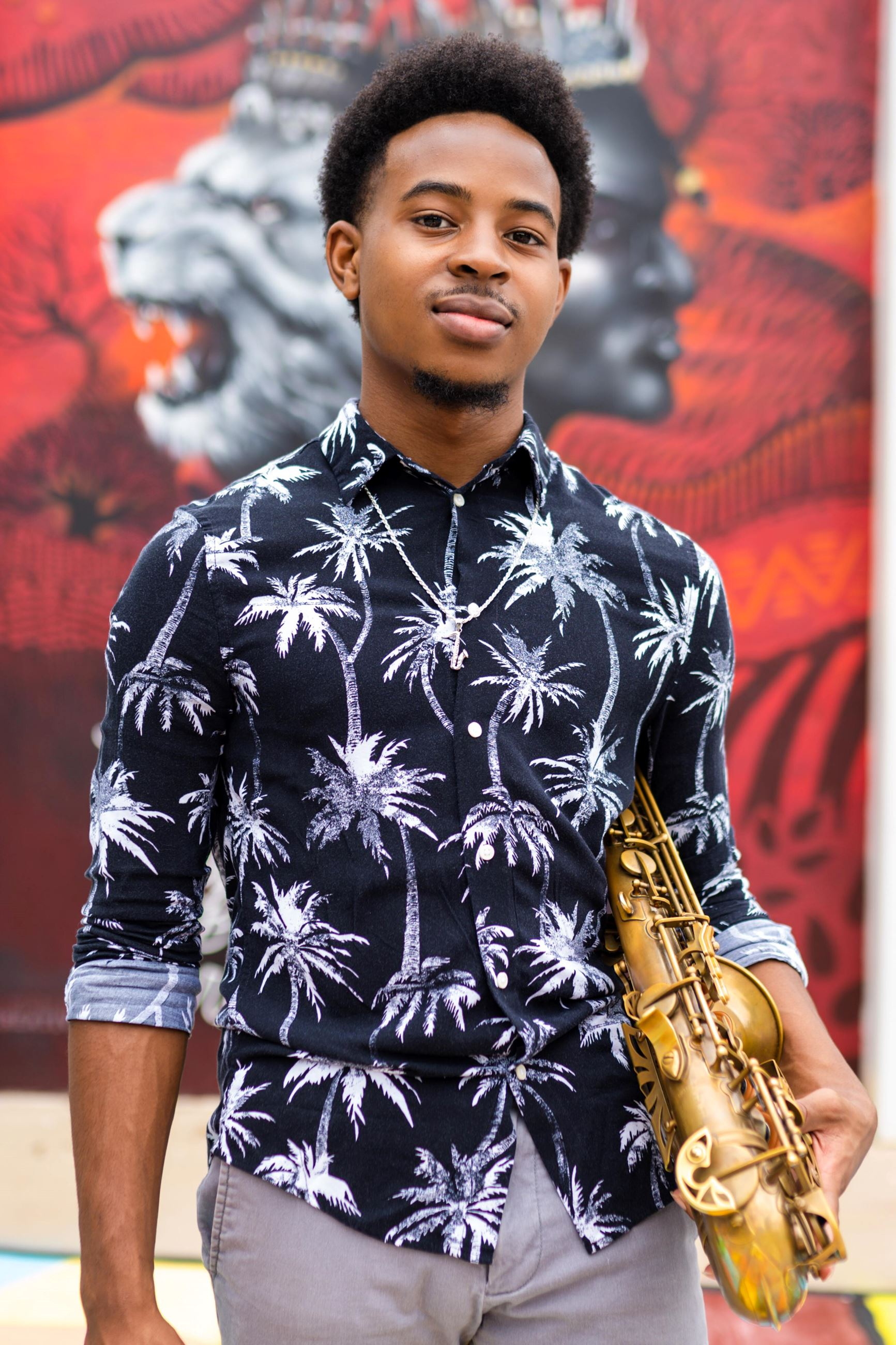 Young man holding a saxophone